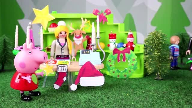粉红小猪 佩奇和乔治在装扮圣诞树