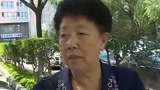 """哈尔滨:女子跑了两三年 车库""""办证""""难"""
