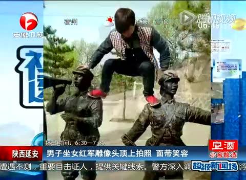 风景区明孝陵石象路上,发现一位美女骑在文物上玩自拍,不停地变换姿势